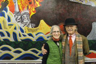 Drs. Zohara and Bob Hieronimus at their Apocalypse mural at Johns Hopkins University
